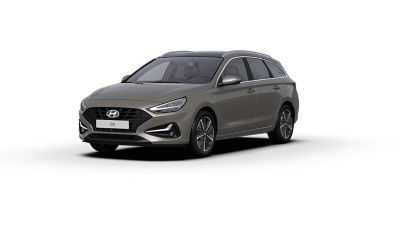 Front side view of the new Hyundai i30 Wagon in the colour Silky Bronze Metallic.