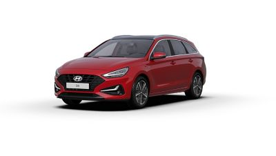 Front side view of the new Hyundai i30 Wagon in the colour Sunset Red.